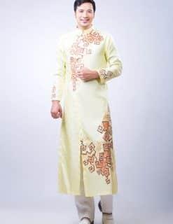Áo dài nam vàng nhạt họa tiết cam trẻ trung