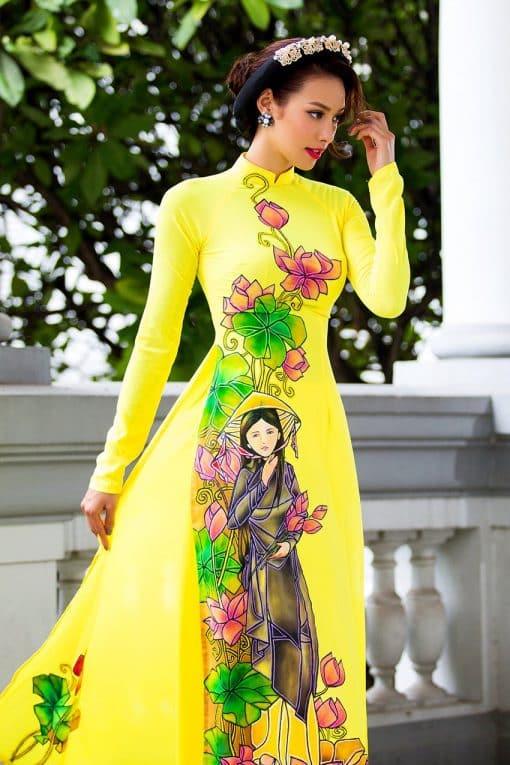 Áo dài nữ vàng vẽ hình ảnh thiếu nữ