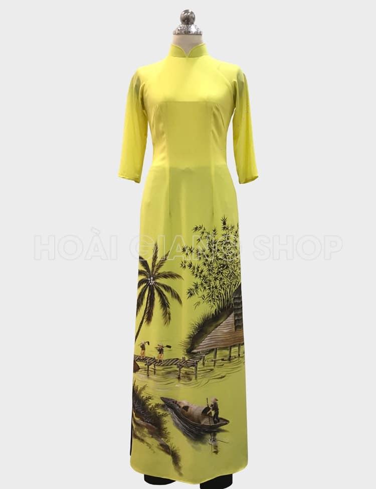 áo dài nữ màu vàng vẽ phong cảnh