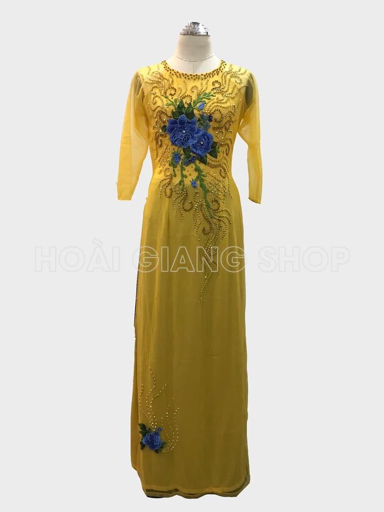 áo dài mẹ cô dâu màu vàng